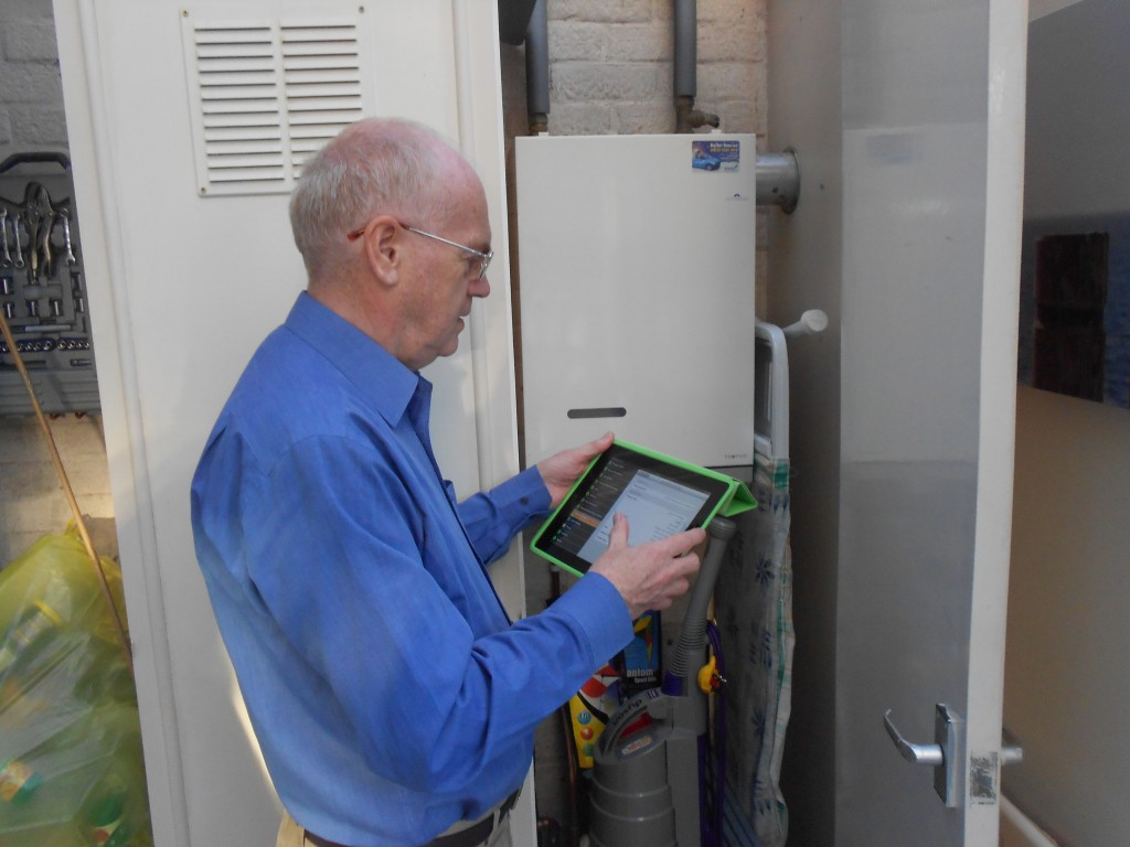 Peter Bates doing an energy assessment of a local house